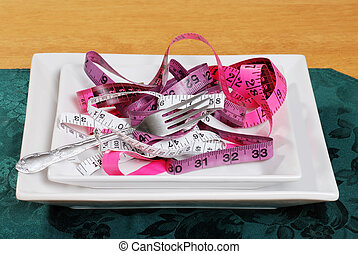 tape measures on a plate with fork