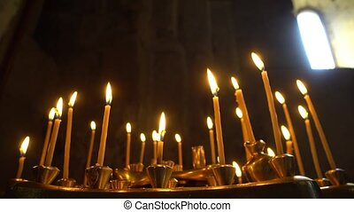 Taper Candles Burning in Church - Taper candles burning in...