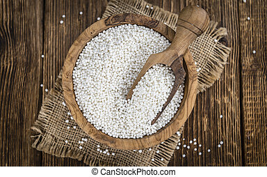 Tapioca Pearls (close-up shot) on rustic wooden background...