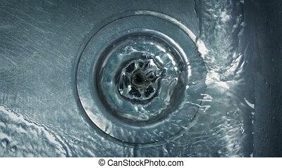 Taps Running In The Sink - Water runs down sink in kitchen