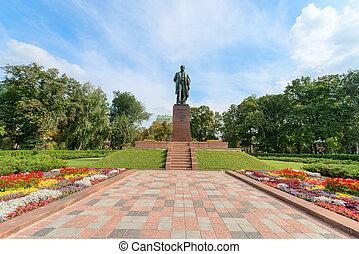 Taras Shevchenko monument in Shevchenko park, Kyiv, Ukraine under blue sky