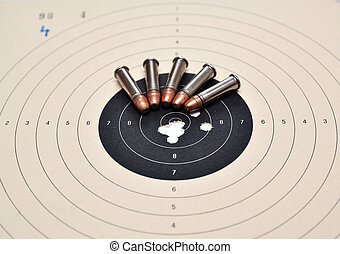 Target and ammunition - Detail on holes in target and...