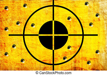 target on the wall with hole from shoot