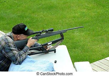 Target practice - Senior gentleman that is target practicing...