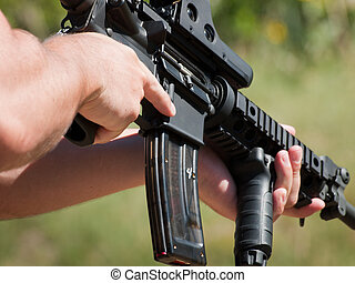 Firearm AR-15 for target shooting.