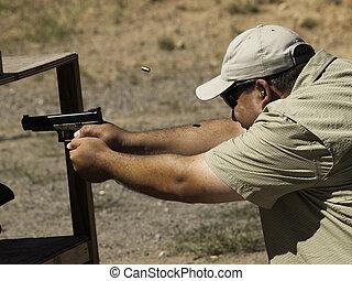 Target Shooting - Man practicing target shooring.