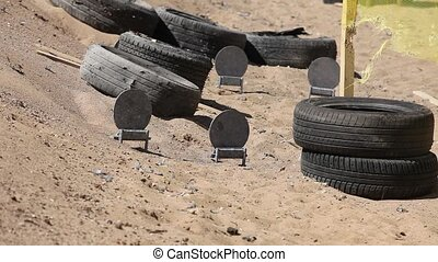 Target Shooting - target practice in a sandpit shooting...