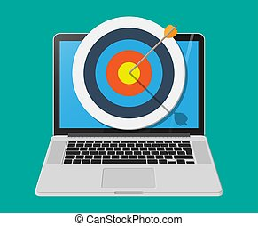 Target with arrow in cente on laptop screen