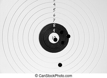 Target with bullet holes - Close up of target with bullet...