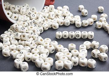 Target word written on wood block. Wooden ABC