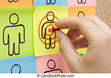 Target Your Customers Hand - Hand pinning a sticky note in ...