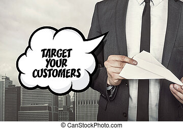 Target your customers text on speech bubble with businessman holding paper plane