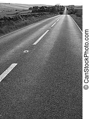 Tarmac road perspective - Tarmac road leading off into the...