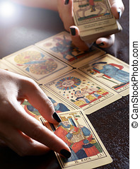 Tarot Card Reader Performing Reading - Close Up of Female...