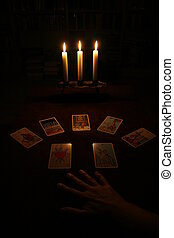 tarot cards - hand and cards