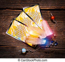 Tarot cards on a board - Tarot cards, dowsing tool and...