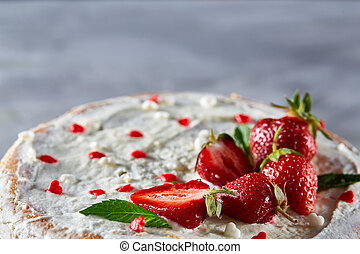 Tart with strawberries and whipped cream decorated with mint leaves on white textured background, selective focus