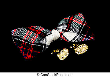 Tartan Bow Tie and Cuff Links on a Black Background