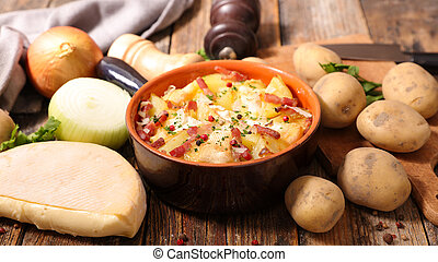 tartiflette, baked potato with cream,bacon and cheese