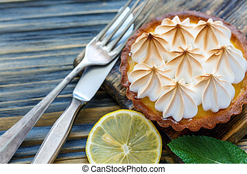 Tartlet of lemon custard and meringue. - Tartlet with lemon...
