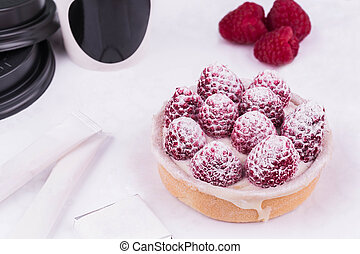 Tartlet with butter cream and fresh raspberry, is served with kofy