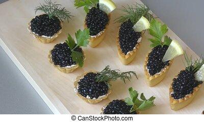 tartlets, caviar, noir