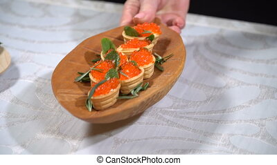 Tartlets with caviar on the table