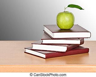 tas, livres, pomme verte