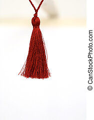 tassel background - red rope with tassel isolated on white
