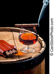 Taste of burnt cigar and cognac