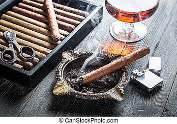 Taste of cognac and cigar fuming