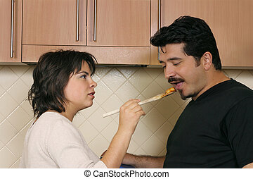 Taste - A woman offers pasta to her husband