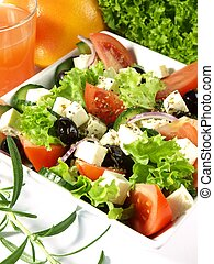 Colorful and appetizing greek salad with garnish