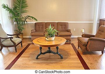 A beautiful sitting room with hardwood floors
