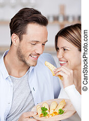 Tasting cheese - Young couple enjoys cheese tasting from a...