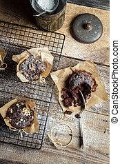 Tasting freshly baked chocolate muffins