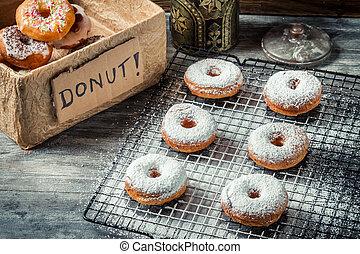 Tasting freshly baked donuts