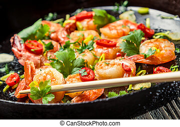 Tasting Fried shrimp with chopsticks