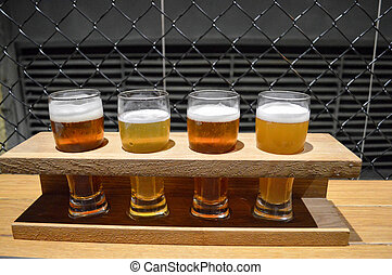 tasting of craft beer in the bar, four glasses