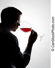 tasting wine - young expert sampling red wine