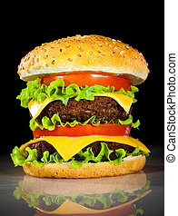 Tasty and appetizing hamburger on a dark