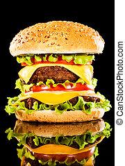 Tasty and appetizing hamburger on a dark background