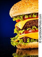 Tasty and appetizing hamburger on a dark blue