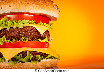 Tasty and appetizing hamburger on a yellow