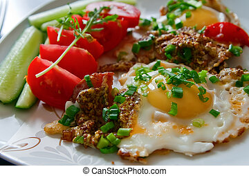 close-up breakfast - fried eggs with bacon, french mustard, green onion and fresh vegetables