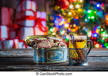 Tasty and sweet tea and gingerbread cookies at Christmas eve