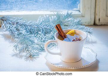 Tasty and sweet tea with cinnamon and orange for Christmas