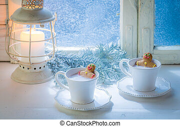 Tasty and sweet two gingerbread man in cup for Christmas