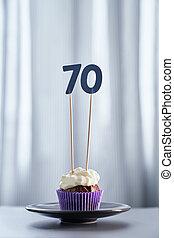 Tasty anniversary chocolate cupcake with number 70 seventy