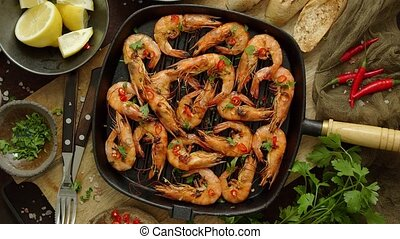Tasty appetizing roasted shrimps prawns with spices on pan ...